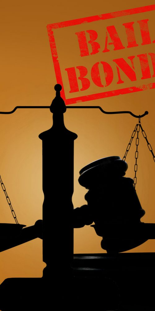 Court gavel and scales of justice with Bail Bonds stamp