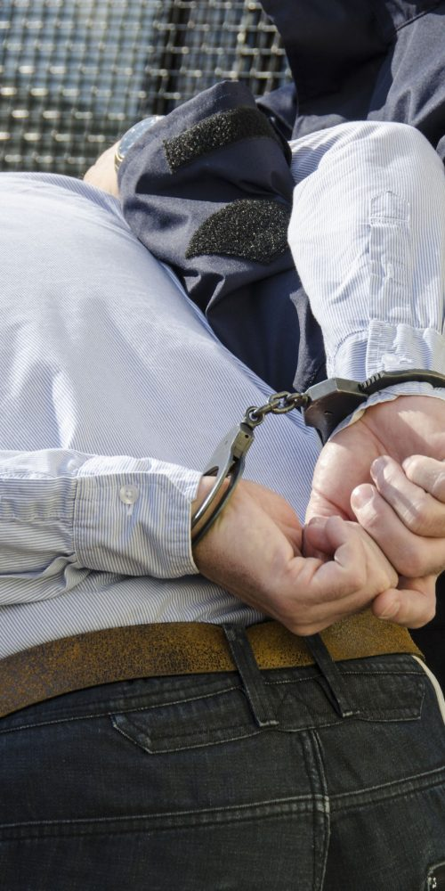 the photo shows the arrest of a man